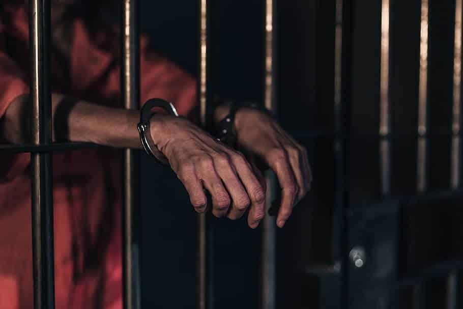 ຖືກຈຳຄຸກ 12 ປີ ຖ້າບໍ່ປະຕິບັດມາດຕະການກັກຕົວ - prison bars jail imprisoned justice arrest - ຖືກຈຳຄຸກ 12 ປີ ຖ້າບໍ່ປະຕິບັດມາດຕະການກັກຕົວ