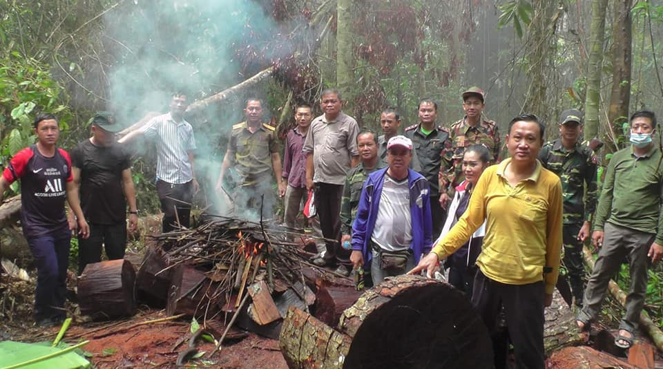 Authorities destroy illegal timber in Kasi District, Vientiane Province.
